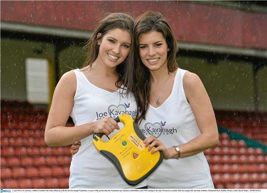 Julie Kavanagh and Judy Kelleher at the presentation of a defibrillator to St. Pats FC.